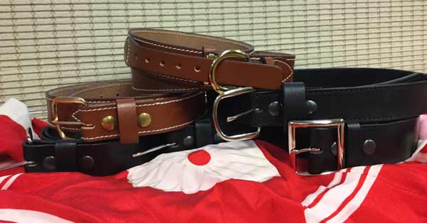 black-and-brown-leather-belts